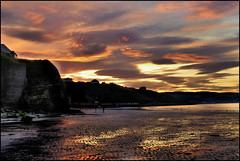 Whitby sunset. (Country Girl 76) Tags: whitby yorkshire seaside sunset beach sand cliffs people reflections sea clouds huts