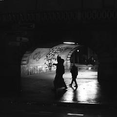 With the little boy (pascalcolin1) Tags: paris13 femme woman enfant child boy garçon nuit night pluie rain lumière light tunnel chanel photoderue streetview urbanarte noiretblanc blackandwhite photopascalcolin 50mm canon50mm canon