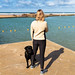 Bude tidal swimming pool, lady and  her dog, UK