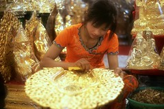 The Art of Gilding (*Kicki*) Tags: myanmar burma mandalay woman female person handcraft art gilding gild portrait facesofmyanmar gold golden 50mm bokeh people asia candid glow workshop skills tradition cultural ornament working buddha မြန်မာ