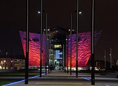 Titanic Belfast. (carolinejohnston2) Tags: building architecture capital night city sky red lights belfast northernireland docks nighttime