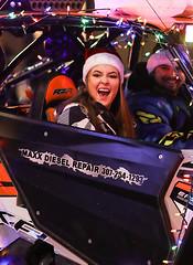 Shout out (wyojones) Tags: wyoming cody christmasparade sheridanavenue snow cold sidebyside sxs offroadvehicle utv rov lights christmasseason parade man driver tailights woman shout greeting smile drive wyojones