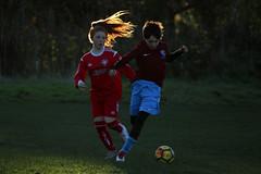 Venus and Mars play football (Wilamoyo) Tags: football soccer kids compete sport children boy girl run running ball field match pitch light hair contrast