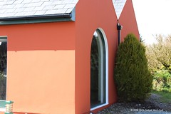 Exterior painting red cottage