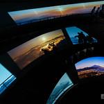 "The huge ""upside down Mt.Fuji"" is exhibition hall.  There are several huge screens which display various Mt.Fuji as time-lapse, while visitor climbing spiral slope. So we can enjoy virtual climbing the Mt.Fuji. 巨大な""木の逆さ富士""は実は展示ホールだったのです。巨大なスクリーンがいくつもあり、様々な富士の表情がタイムラプスの映像を鑑賞しながら螺旋状のスロープを登ることで登山気分を味わえます。 展示部の撮影は、映像は撮影OKで、中心部の展示資料は撮影NGです。ここからのアングルがスタッフ様おすすめの「見えるスクリーン数が最も多い画角」です。親切。"