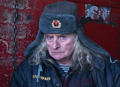 From Russia ... to Glasgow (Charles Hamilton Photography) Tags: glasgow glasgowcharacter thebarrasmarket eyecontact characterstudy colourstreetportrait russian winteringlasgow naturallight environmentalportrait primelens glasgowstreetphotography charleshamilton nikond750