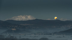 ending eclipse (andreasbrink) Tags: italy monterosa mountains taino winter moon eclipse landscape bloodmoon roccadiangera