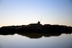 Fisher (busitskee) Tags: sky water minimalism waterscape fish fisherman fisher rocks canon