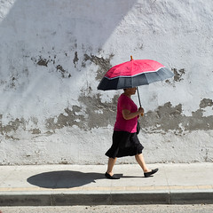 BYO Shade (OneEighteen) Tags: cartagenadeindias colombia streets 2019 woman walking sunshine umbrella parasol shade shadow
