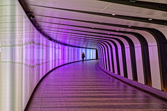 Kings Cross (Croydon Clicker) Tags: tunnel passageway modern person curve violet london kingscross underground