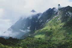 Clouded (Julie Ehrlich) Tags: mountain mountains clouds cloud green greens blue blues white whites trees tree forest forests rock rocks peak top nature naturephotography landscape thailand