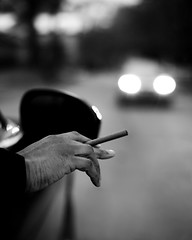 Shotgun (Anthony. B) Tags: 50mm18g d7000 nikon riding portrait hand white black bnw blackandwhite cigar smoking lights blur bokeh evening night late car driving
