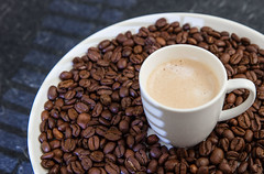 Coffee beans and cappuccino (annick vanderschelden) Tags: coffee bean coffeebeans brewer flavour roasted intense solid fiery espresso refined aroma taste colour seed pit caffeine beverage alkaloid proteins carbohydrates endosperm arabica plate layer cappuccino milk foam belgium
