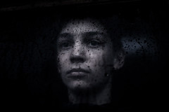 Black rain, autumn 2018 (PaxaMik) Tags: portrait portraitnoiretblanc noiretblanc noir n§b rain rainingdays raindrops throughthewindow window drops mélancolie melancholy face visage autumn automne blackeyes teen frenchportrait