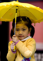Chinese Girl With A Yellow Umbrella, Beijing, China (Eric Lafforgue) Tags: asia beijing beijinggirl0628 casualclothing child childhood childrenonly china chinese chineseculture chineseethnicity colorpicture confidence day eastasianethnicity frontview girl happiness headandshoulders innocence kid lookingatcamera onegirlonly onepeople oneperson outdoor parasol pekin portrait realpeople serious sunshade travel umbrella vertical yellow