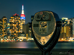 Look Thru These, The Sight Will Be Golden (Brian D' Rozario) Tags: newyork unitedstatesofamerica brian19869 briandrozario nikon d750 binocular binoculars empirestatebuilding empirestate bokeh bokehcity bokehlicious nyc citylights golden forevernewyork longexposure hdr highdynamicrange cityscape skyscraper skyscrapers spire river reflection travel capitaloftheworld
