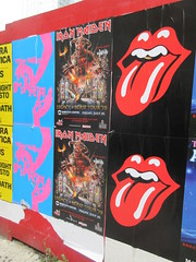 Iron Maiden with Rolling Stones Lips and Tongue Posters 5257 (Brechtbug) Tags: iron maiden concert poster blue construction fence eddie devil monster zombie album british heavy metal skeletal sidekick west 45th street nyc 2018 november 11182018 brit soldier creepy demon dude union jack flag torn billboard posters billboards cover art