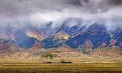 Aspen, snow and thunder (andy_8357) Tags: san luis valley colorado southern mountains autumn fall aspen colors clouds snow thunder sel55210 55210mm f4563 oss sony a6000 alpha 6000 ilce6000 ilcenex dramatic beautiful field vast scale mountain outdoors landscape mountainscape emount