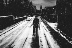 listen, the snow is falling (matthias hämmerly) Tags: switzerland candid street streetphotography shadow contrast grain ricoh gr black white bw monochrom monochrome city town urban blackandwhite strasse people monochromphotography dark zürich zuerich lonely cold winter swiss einfarbig linien gebäude snow silhouette staefa