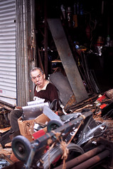 Scrap Shop   Hong Kong (香港), China (Ping Timeout) Tags: hong kong hongkong china sar 香港 island south special administrative region people's republic prc territory december 2018 vacation holiday trip 香港特區 香港特区 street photography market alley people person portrait candid junk scrap metal old shop stall door trolley part outdoor vendor cat sheung wan central second hand antique chinese hollywood upper lascar row lok ku httpwwwcatstreethk
