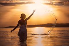 Baptism ({jessica drossin}) Tags: jessica drossin jessicadrossin portrait splash water lake sky clouds light canon ripples sunset wwwjessicadrossincom