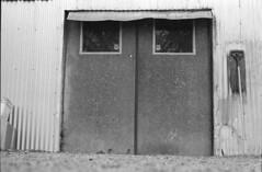 coffee shop side door (ThroopD) Tags: oldindustrial corrugatedmetal moppingaftermath filmchemistry chemistryartifacts scannedfilm anycamerawilldo
