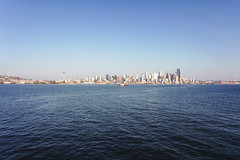 Seattle-Bainbridge Ferry-12 (_futurelandscapes_) Tags: none seattle bainbridgeisland ferry washington transit boat water cityscape skyline autumn sunny bluesky clear bright calm travel vacation city spaceneedle highrise industrial waterfront pier pikeplace
