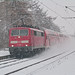 Morning train in snowstorm