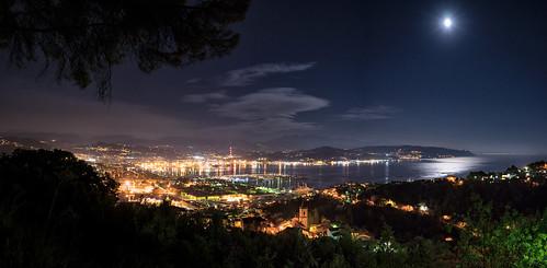 Panorama of the full moon over the port city of La Spezia in Liguria, Italy