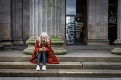 A Big Fluffy Coat (Leanne Boulton (Away)) Tags: urban street candid portrait streetphotography candidstreetphotography streetlife candidportrait woman female girl face expression mood sitting steps mobile smartphone phone technology bright colourful fashion style fur coat furry columns architecture blonde beauty beautiful tone texture detail depth composition naturallight outdoor light shade city scene human life living humanity society culture lifestyle people canon canon5dmkiii 50mm ef2470mmf28liiusm color colour glasgow scotland uk