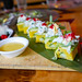 California Roll (Nikkei)- Potato causa, jumbo lump crab, spicy mayo, cucumber, avocado, tobiko, huancaina sauce $16