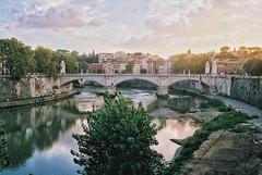 Rome (kunderwet) Tags: tiber rome romaitaly roma 35mm analog film konica konicahexaraf river bridge sky clouds sunset golden hour goldenhour