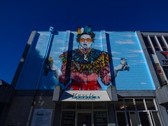Artwork by Fin Dac (Steve Taylor (Photography)) Tags: findac musclepeoplephysiotherapy kingfisher feathers necklace kaitaki oiyou theguardian moko art graffiti mural streetart colourful woman lady newzealand maori nz southisland canterbury christchurch city earrings mask ymca clouds blue calm cool perspective shadow autumn cloud sky sunny sunshine
