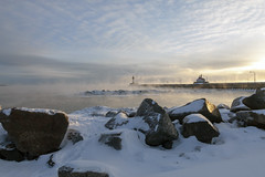 Cold morning in Duluth on the shore of Lake Superior (Lucie Maru) Tags: duluth minnesota cold frozen lake lakesuperior lighthouse snow rock rocky rockyshore sunrise fog steam morning