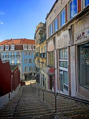 The steps going down from Carmo to Baixa (VillaRhapsody) Tags: lisbon portugal city citytrip winter capital steps carmo baixa hills houses
