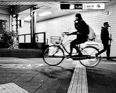 Losing my religion (cresting_wave) Tags: iphoneography mobileography iphonephotography mobilephotography streetphotography nightphotography blackwhite monochrome iphonex procamera snapseed bike bicycle riding rider subwaystation girl man motion blur