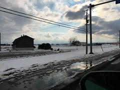 Snowy Fields 2 (sjrankin) Tags: 16march2019 edited naganuma hokkaido japan snow farms fields clouds sky weather road sun glare eniwa kitahiroshima