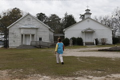 Hillman walks away from an abandoned African-American schoolhouse and towards New Bethel Baptist Church. She believes that not enough is being done in her community to help celebrate and preserve historically African-American buildings in Greene County.