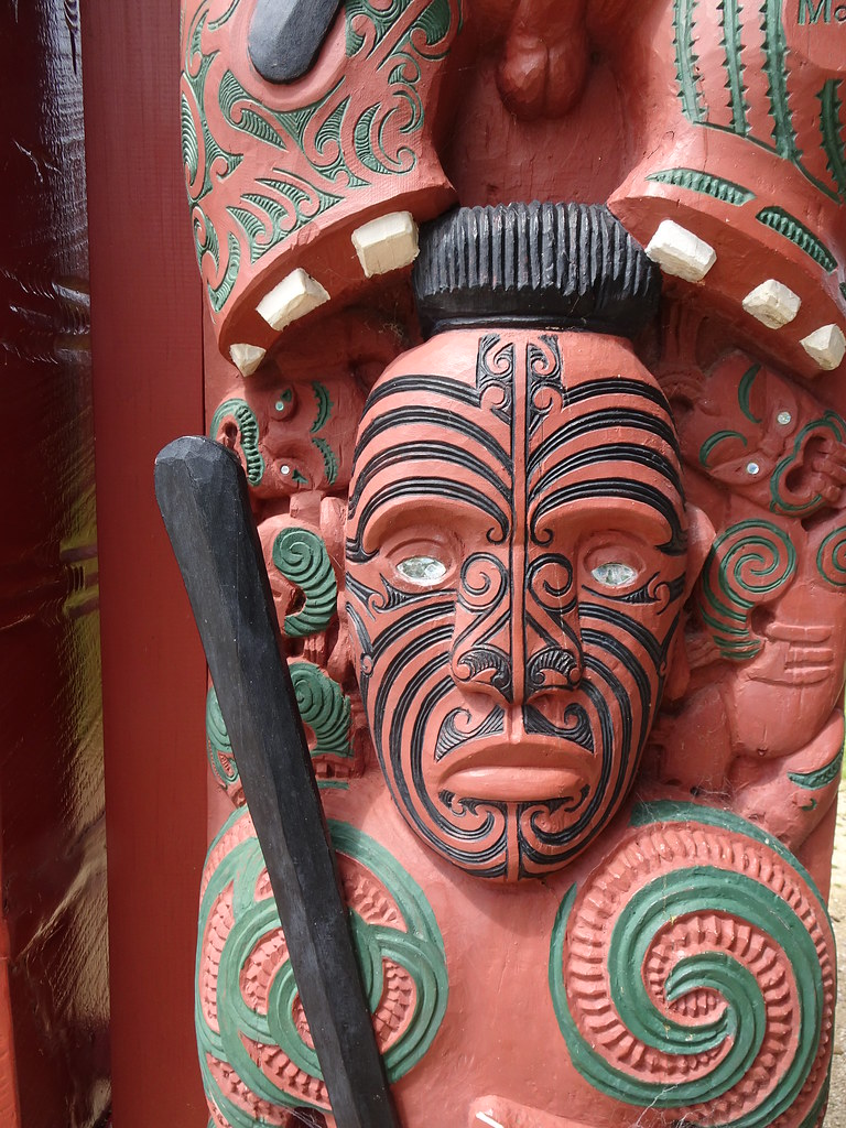 Waitangi. Carved Maori warrior with mother of pearl eyes outside the Marae in the grounds of the Waitangi Treaty House.