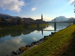 November morning in Salzburg (echumachenco) Tags: müllnersteg bridge hohensalzburg festung fortress castle steeple church iphone österreich austria landscape outdoor fall autumn november salzach city reflection water river morning salzburg