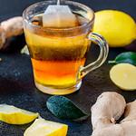 Ginger root tea with lemon on dark background thumbnail