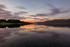 Te Anau at Sunrise (AFracturedCrown) Tags: sunrise orange pink clouds cloudporn cloud reflections mirror lake boats teanau newzealand longexposure