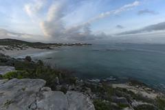 AR53 (jennypowisphotography) Tags: blues clouds sea bay rocks beach sand