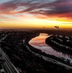 Apartment Views (L. Brannan) Tags: sunrise reflection river sky colour color clouds views landscape water sun