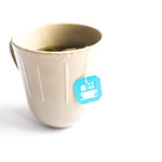 A cup of tea with a tea bag on white background thumbnail
