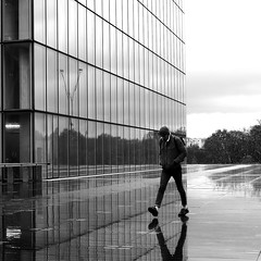 The decided man (pascalcolin1) Tags: paris13 homme man pluie rain reflets reflection décidé decided bnf photoderue streetview urbanarte noiretblanc blackandwhite photopascalcolin 50mm canon50mm canon