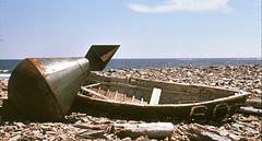 Buoy & wooden boat (PhotonArchive) Tags: gaspe gaspesie quebec pq shoreline beach buoy boat rowboat seaside ocean atlantic fishing dory derelict abandoned driftwood sea novascotia buoyant