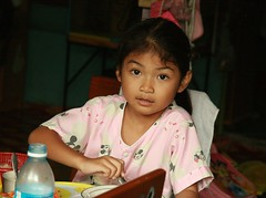 girl in her mickey mouse pajamas (the foreign photographer - ฝรั่งถ่) Tags: girl child mickey mouse pajamas seated table breakfast khlong thanon portraits bangkhen bangkok thailand canon