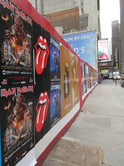 Iron Maiden with Rolling Stones Lips and Tongue Posters 5250 (Brechtbug) Tags: iron maiden concert poster blue construction fence eddie devil monster zombie album british heavy metal skeletal sidekick west 45th street nyc 2018 november 11182018 brit soldier creepy demon dude union jack flag torn billboard posters billboards cover art with rolling stones lips tongue
