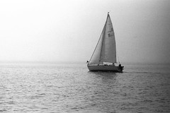 Good Golly sailing into the Fog (JBAdams) Tags: nikon nikonf3 nikkor105f25 kodakbw400cn bw400cn film analog manualfocus availablelight sailboat sailing sail yacht yachting regatta fog bw blackandwhite maine merriconeagyachtingassociation 35mmfilm